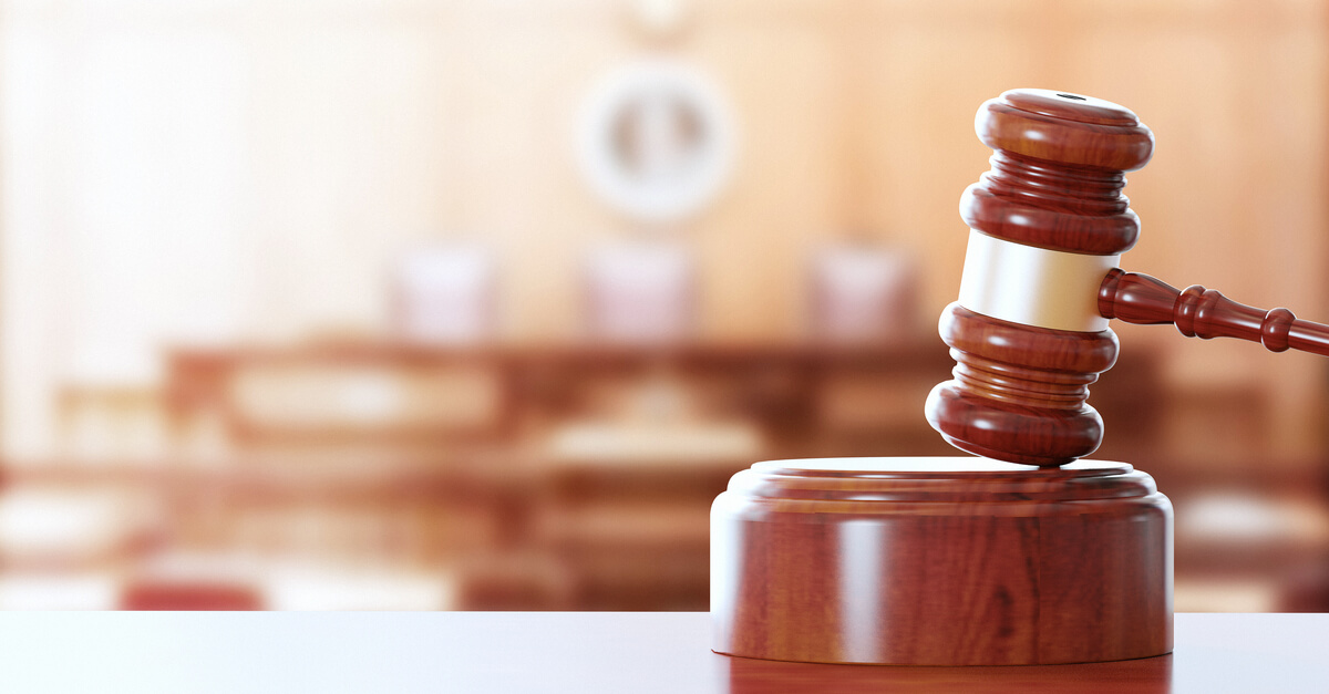 a gavel sits in a courtroom
