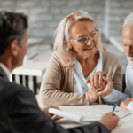 an older couple reviews documents with a younger professional